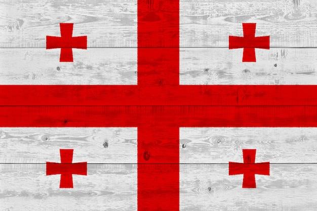 Georgia flag painted on old wood plank