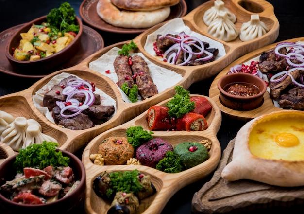 Georgian cuisine food set. khachapuri, dolma, satsivi, khinkali, pkhali. georgian restaurant.