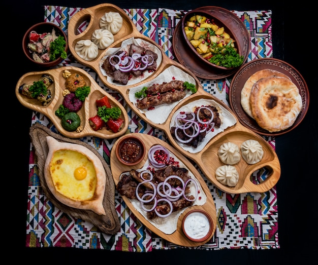 Georgian cuisine food set. khachapuri, dolma, satsivi, khinkali, pkhali.