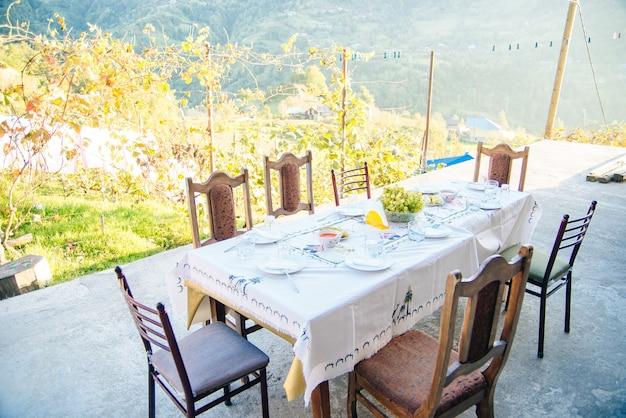 Georgian feast on the vineyard at sunset.