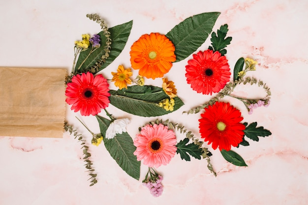 Gerbera flowers with green leaves and branches