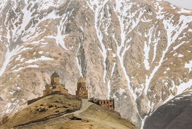 Gergeti temple on top at the foot of the kazbek mountain