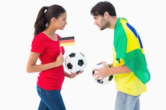 German and brazilian football fan facing off