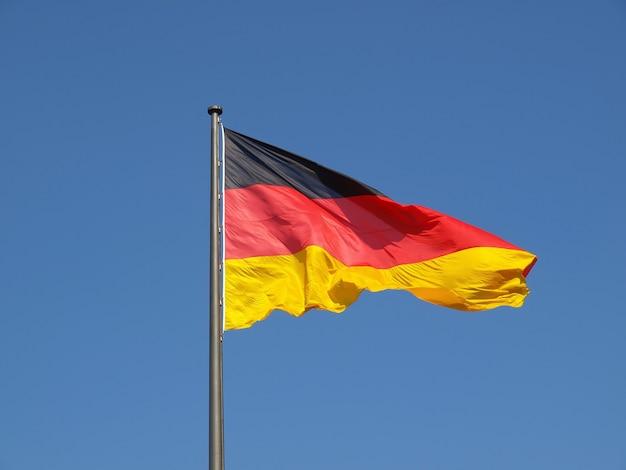 German flag over blue sky