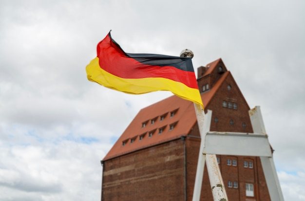 German flag flaps on the wind in stralsund, germany