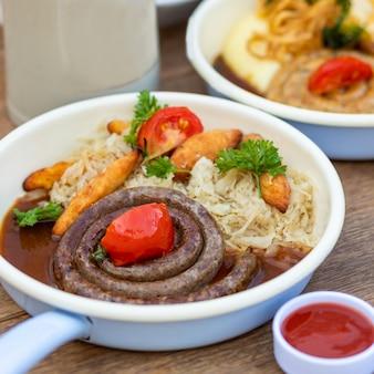 German sausage, meat meal sauce, close up