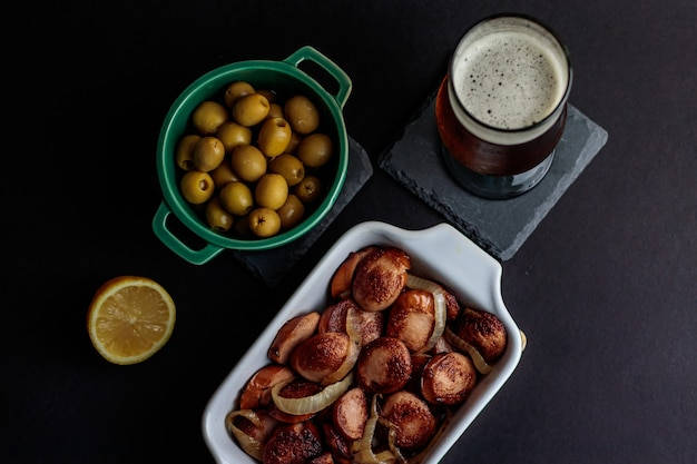 German sausage with olives and craft beer