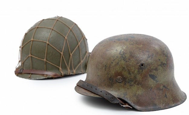 German and u.s  world war two military helmets, battle of normandy 1944