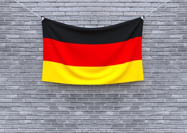 Germany flag hanging on brick wall