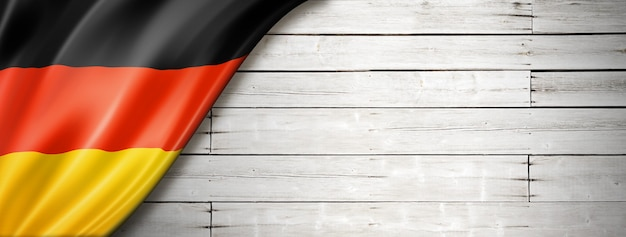 Germany flag on old white wall. horizontal panoramic banner.
