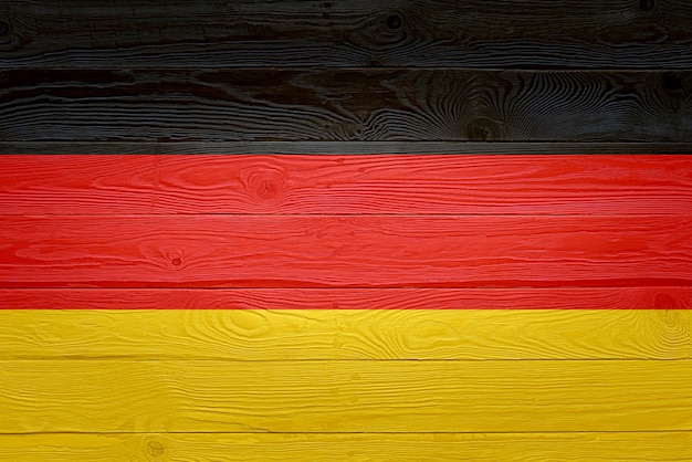 Germany flag painted on old wood plank background