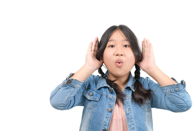 Gesture and emotion concept - cute girl having hearing problem listening to something isolated on white background