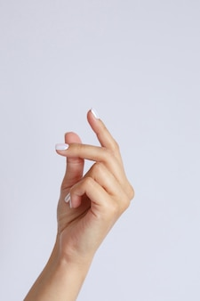 Gesture and sign, female hand on white. hand click or snapping fingers