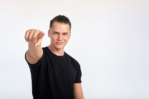 Gesture. young handsome confident smiling man pointing at you