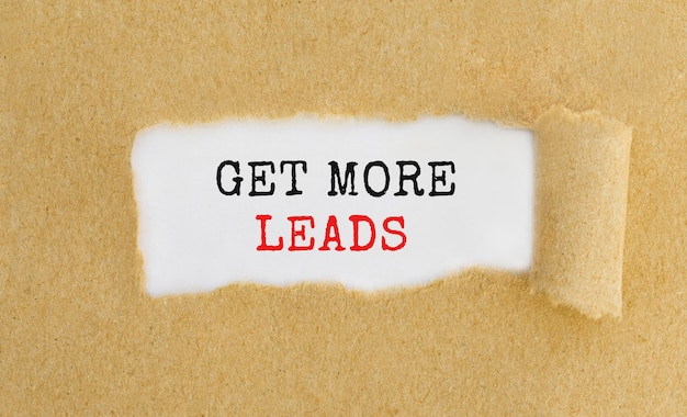 Get more leads appearing behind ripped brown paper.