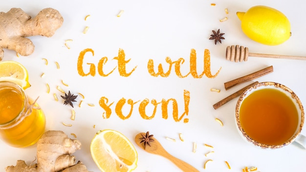 Get well soon - written from ground turmeric on a white background