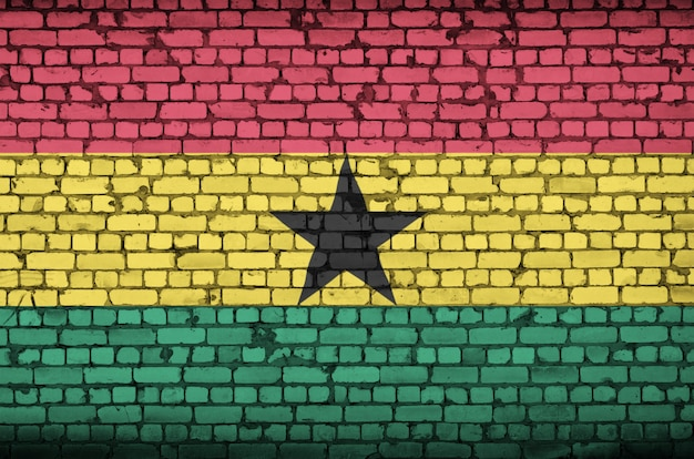 Ghana flag is painted onto an old brick wall