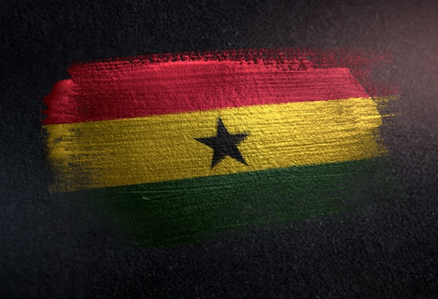 Ghana flag made of metallic brush paint on grunge dark wall