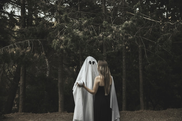 Ghost and lady embracing in park