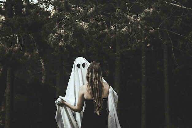 Ghost and lady hugging in park