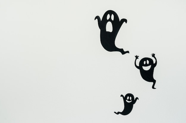Ghost silhouettes on white background