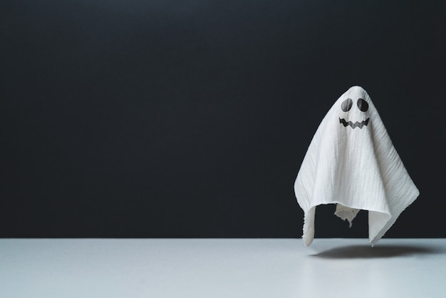 Ghost with a grin and copy space halloween holiday