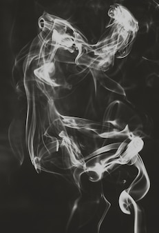 Ghosts smoke abstract on black background