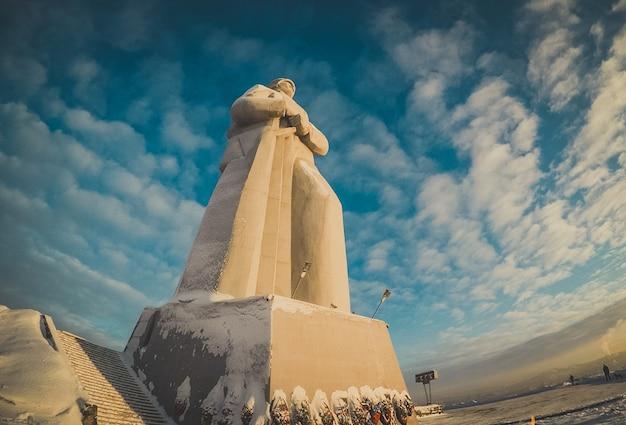 Giant alyosha monument, murmansk. landmark in evening clouds sky.