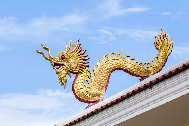 Giant chinese style dragon statue on blue sky background