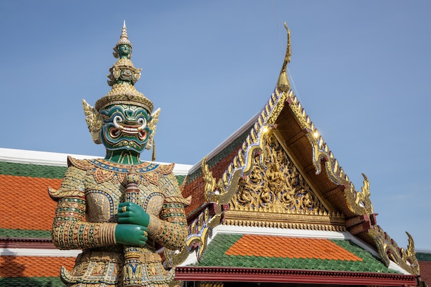 Giant demon guardian standing in  front of wat phra kaew (grand palace) door in bangkok thailand