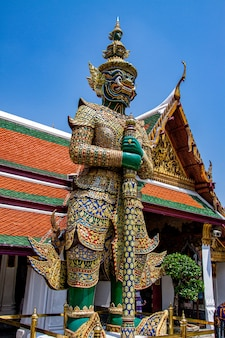The giant guardian is also called a giant demon or yak at wat pho in bangkok