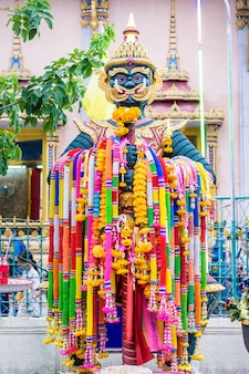 Giant statue hanging garland in the temple