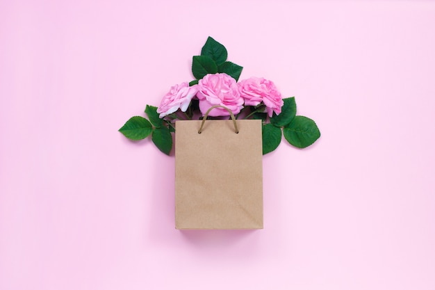 Gift bag with bouquet of pink roses