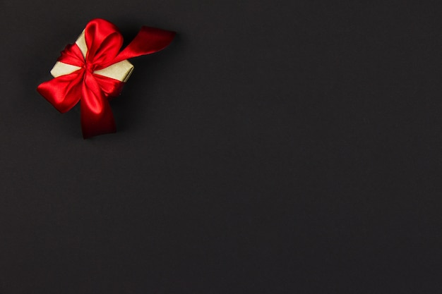 Gift for black friday sale and christmas box with a red ribbon