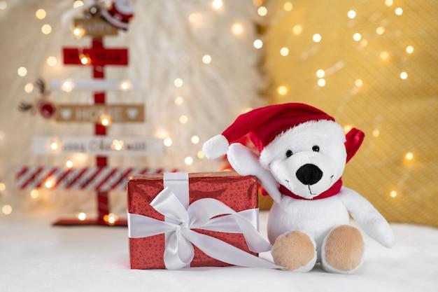 Подарочная коробка и новогодний плюшевый мишка на боке