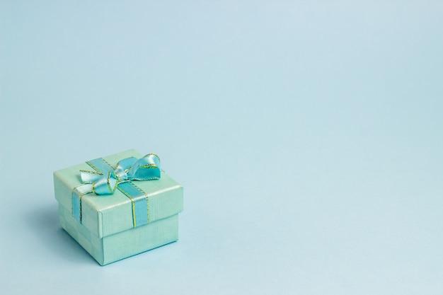 Gift box on blue