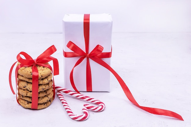 Gift box chocolate cookies tied with a red ribbon heartshaped lollipops