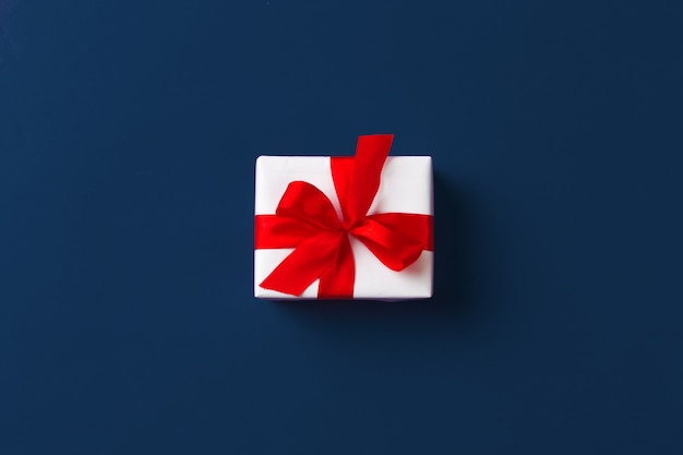 Gift box on classic blue background top view