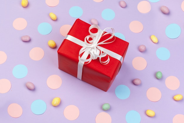Gift box on color background top view