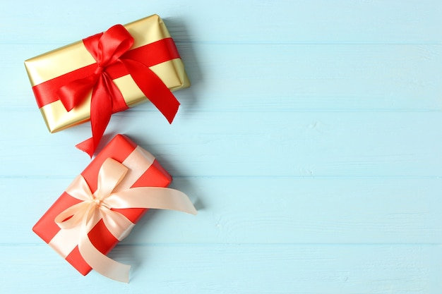 Gift box on a colored background top view