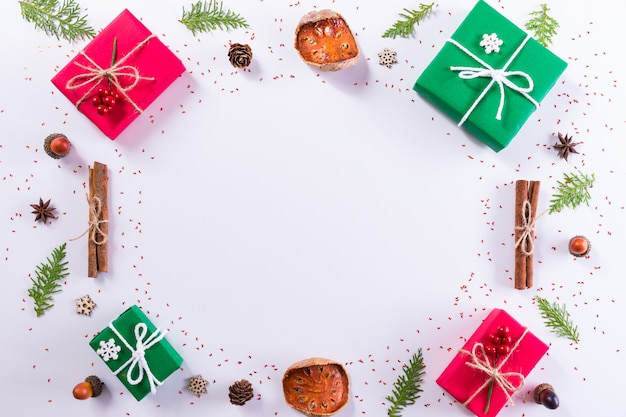 Gift box and decorations on white background. christmas, or new year concept. top view, copy space