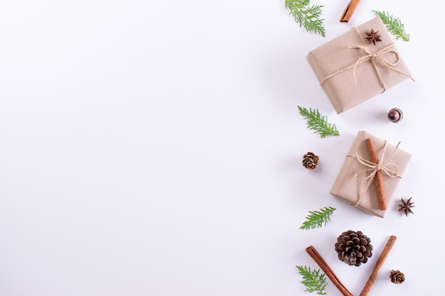 Gift box, fir branches and decorations on white background. christmas, new year concept. top view, copy space