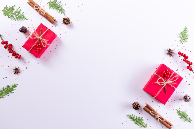 Gift box, fir branches decorations on white background. christmas, or new year concept. top view, copy space