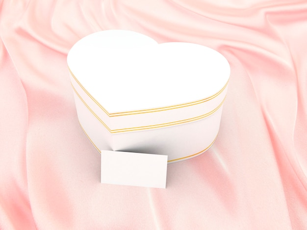 Gift box in form of heart on silk