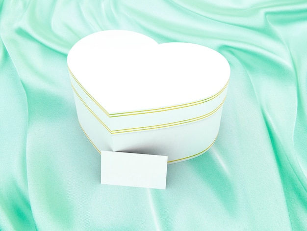 Gift box in the form of heart on silk