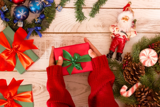 Gift box in girl's hands. open presents. christmas background