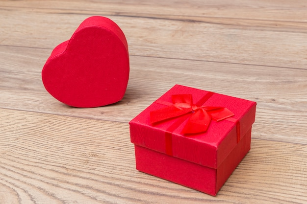 Gift box in heart shape on table