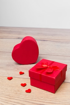 Gift box in heart shape on wooden table