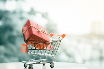 Gift box in small cart about shopping online concept.