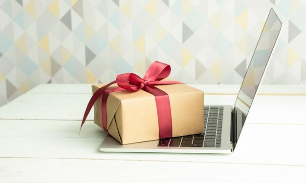 The gift box lies on an open laptop